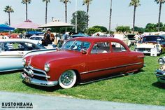 Here's another one of Howard Gribble's photos from the 1995 Sultans of Long Beach hot rod and custom car show held on the athletic field at Millikan High School in Long Beach California.   Except for the ELVIS license plate I guess this mildly restyled shoebox Ford easily could have escaped the little pages from the late 1950s! Lakes pipes. Dummy spots. White rolled and pleated interior. Fender skirts. Shaved door handles. Nosed hood. Caddy hubcaps. A typical high school custom! Go Cat Go!