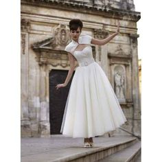 The way the little bolero jacket creates the most perfect neckline ever. | 50 Gorgeous Wedding Dress Details That Are Utterly To Die For