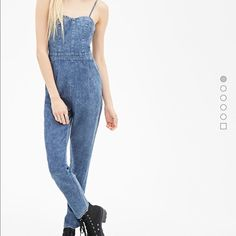 Denim jumpsuit Denim back cutout jumpsuit, has detachable straps for a strapless look. I just ordered it and it didn't fit the way I liked. Very cute. Brand new tags still attached Forever 21 Pants Jumpsuits & Rompers