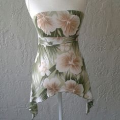 Tropical print tube top It ties in the back and hangs down at the side of your hips. Would be cute with some white skinnies or a light denim mini skirt. Great spring/summer top.  The material is a blend of polyester, spandex, and elastic.   Happy poshing. Forever 21 Tops