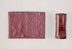 Kassite, 1400BC-1350BC. Streaked pink-orange and orange cornelian cylinder seal; before the seated sun-god Shamash are a Kassite cross and rosette, both probably su...