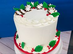 Create a beautiful cake using fondant leaves and cookie stars.