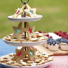 Red, White, and Blue Star Cookies--These festive cookies utilize crushed hard candy pieces to make colored-glass like cutouts. Fourth Of July Food, 4th Of July Celebration, 4th Of July Party, July 4th, Holiday Treats, Holiday Parties, Holiday Fun, Holiday Foods, Blue Desserts