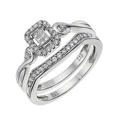 A stunning 1/4 carat diamond bridal set of distinction. The engagement ring features a rectangle halo cluster, set between a smoothly twisting argentium silver ring. A single sparkling diamond is enclosed in the twirling band, resting either side of the cluster centrepiece. Paired with a diamond set argentium silver wedding ring, shaped for the perfect fit.