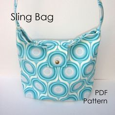 A nice bag with clean lines and a deceptively simple design, the 'slung' look created by the flap closure. The wide strap is easy to carry over your the shoulder and