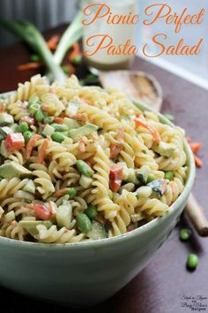 All picnics need this pasta salad - this Picnic Perfect Pasta Salad has a delicious tangy peanut dressing, giving it lots of flavor with less guilt. Picnic Salad Recipes, Potluck Recipes, Pasta Recipes, Dinner Recipes, Cooking Recipes, Healthy Recipes, Potluck Ideas, Potluck Dishes, Rice Dishes