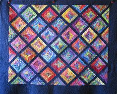 Scrappy Strings   http://quiltinggallery.com/2012/08/17/vote-now-scrappy-quilts-3/