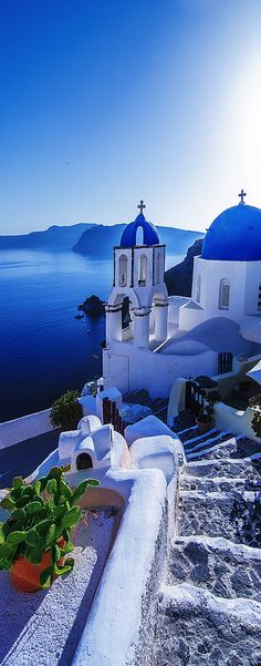 Santorini in Greece guides down from glistening white buildings to sparkling waters!