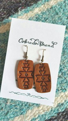 Items similar to Hand carved Leather Earrings with Tribal pattern, Aztec, Navajo, western chic on Etsy Leather Carving, Leather Tooling, Tooled Leather, Leather Case, Leather Projects, Leather Crafts, Leather Pattern, Sewing Leather, Diy Earrings