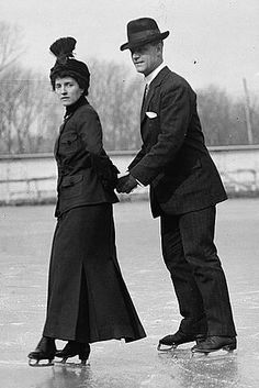 R.P. Hobson & wife on ice skates. Can't imagine doing much more than a skate stroll with that heavy long skirt
