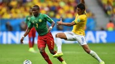 Landry N'Guemo of Cameroon controls the ball against Paulinho of Brazil