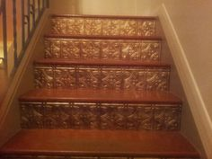 Stair risers made from Faux metallic ceiling/backslash tile available at Home Depot in 2x2 squares