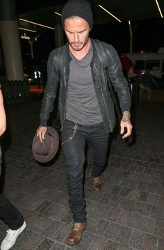 BREAKING: David Beckham wears a hat... and carries ANOTHER hat. Don't question it - just do it.
