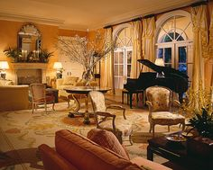 A Distinguished Living Room in Palm Beach, Florida. Scott Snyder has created a lyrical arrangement of round and square shaped elements around the circular central medallion of the Aubusson rug. The gold, yellow, coral, green and white in the Aubusson rug are reflected in the colors of the upholstery, drapery, wall and ceiling. Image Courtesy Scott Snyder.