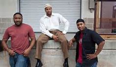 THREE MUSLIM BROTHERS RELAXING AFTER WORK.