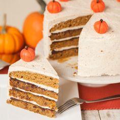 The best delicious fall dessert is this moist homemade Layered Pumpkin Cake with hazelnut buttercream, drunken chocolate ganache, and marzipan pumpkins!