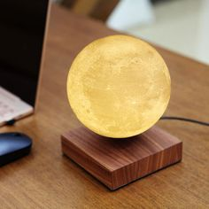 I can't believe this exist!! Levimoon Light floats above its wooden base as it slowly spins. You can adjust the color temperature of the moon from warm yellow to cold white depending on your mood. #moon #moonmood #levitation #tablelamp  #ad