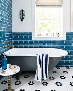 Black bathtub with Blue subway tile in a coastal bathroom Coastal Inspired Bathrooms, Black Bathtub, Blue Subway Tile, Grey Tiles, Fireclay Tile, Beach House Kitchens, Décor Boho, Family Bathroom, Bathroom Bin