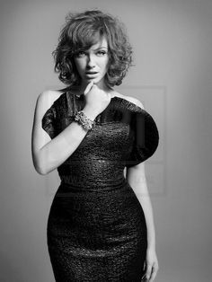 Christina Hendricks, highlighting her fabulous figure.