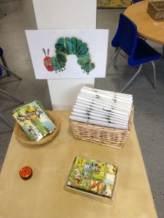 Small challenge table, where children find their personal challenge book and complete a different challenge each day. This one is to select a picture card and then use the puzzle blocks to make the same picture. Intense concentration and observational skills required!