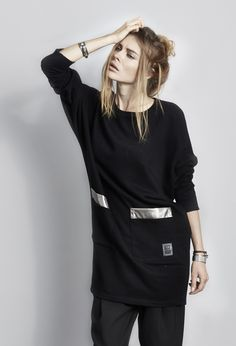 Gorgeous black sweatshirt dress with batwing sleeves and pocket trims in metallic leather.