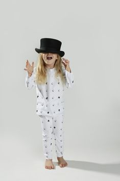 The Didi + Bud Black Top Hat Pyjamas provides a delicate addition of quintessentially English set on crisp, white cotton. OEKO Tex Certified Cotton with water based inks. Machine washable at 30 degrees. Childrens Pyjamas, Black Top Hat, 30 Degrees, White Cotton, Bud, Crisp, Delicate, English, Hats