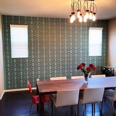 A DIY stenciled accent wall in a dining room using the Connection Allover Stencil. http://www.cuttingedgestencils.com/wallpaper-stencil-connection.html