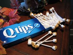 "~ Earwax Swabs ~ Gross? okay.  Creative? You Bet!   All you do is pop two marshmallows on each end of a lollipop stick and dip them in butterscotch!  Easy, right?  The Q-tips box a must! Enjoy!  A pinner said, ""Yeah, I made these for our Halloween Boo Bash this year and they were a smash! Everyone was grossed out, but said that they tasted delicious!"""