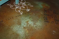my laundry/craft room floor, i used stencils over acid stained concrete floors
