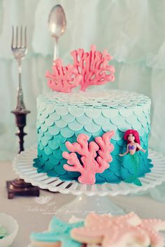 Ombre petal cake for a mermaid birthday party.  Have to remember this in case a certain little girl ever asks me for an Ariel cake :)