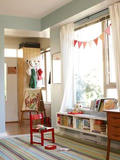 I love this low shelf because of its accessibility.  It's a converted shelving unit and by installing it above the floor it maintains a nice open feel. A nice floor pillow or 2 and all those wonderful books and play items are directly within reach (no need to climb!)