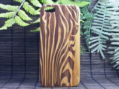 Zebra iPhone 7 Plus Case. EcoFriendly Bamboo Wood Cover. iPhone 7 Plus Case. Protect your valuable iPhone 7 Plus with a one-of-a-kind bamboo case. The laser engraved design features artwork of a zebras face. The zebras black and white stripes camouflage it against predators, however to the herd members the patterns are unique from zebra to zebra, helping to identify one another. Blending into a crowd without losing your individuality is the Zebra spirit. The animal print stripe pattern also…