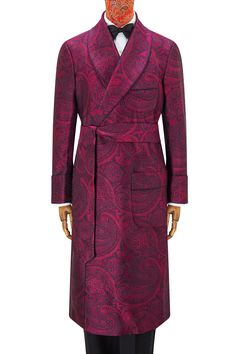 The rich magenta paisley silk of this gown is woven in Suffolk, using time honoured skills and techniques. The gown itself is then handmade, also in England. It has matching revers and gauntlet cuffs and is piped throughout with a deep purple cording. It is fully lined in magenta satin and has two patch pockets and a chest pocket