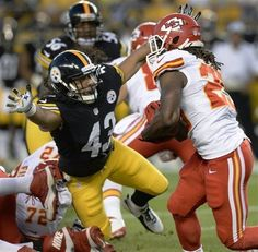 Pittsburgh Steelers strong safety Troy Polamalu (43) dives to tackle Kansas City Chiefs running back Jamaal Charles (25) in the first quarter of an NFL preseason football game on Saturday, Aug. 24, 2013, in Pittsburgh. (AP Photo/Don Wright)