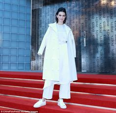 By storm: Kendall Jennerpositively glowed as she took to the red staircase at the Ports 1...