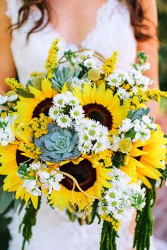 daisy and sunflower wedding bouquets. happy happy happy.