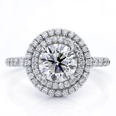This #engagement ring is #French-pave set with 0.55cttw of #brilliant cut #round #diamonds. #rings #doublehalo #halo Adiamor