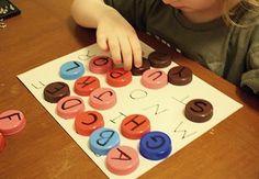 Alphabet recognition match bottle caps to ABC mat