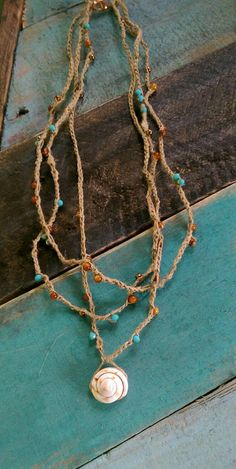Check out this item in my Etsy shop https://www.etsy.com/listing/260994543/3-strand-hand-crochet-hemp-necklace-with