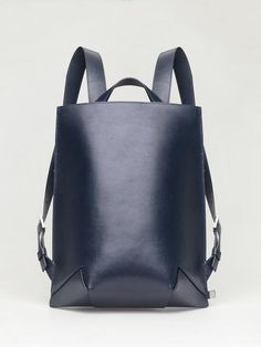 Genuine leather backpack of structured body with handpaintedcut edges. The bag opens on the top by a metal zip.Undivided inside space with mounted leather linin