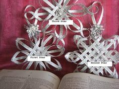 These woven stars are beautiful and are a lot easier than they look.  The link shows you how to make the star to the right but it provides links to the other two as well