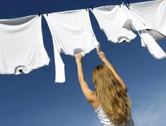 Photo about Longhaired young woman reaching white laundry which hangs to dry in a summer breeze on a clothes-line. Image of clothespins, energetic, line - 1674676 Natural Bleach, Becoming Minimalist, Laundry Hacks, Minimalist Wardrobe, Minimalist Lifestyle, Quites, Clothes Line, Facon, Simple Living