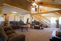 Open living room in a wood post & beam barn home | Sand Creek Post & Beam Barn Kits  https://www.facebook.com/SandCreekPostandBeam?focus_composer=true&ref_type=bookmark