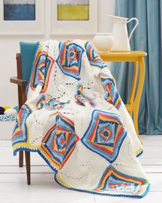 Graphic squares in bold pop colors add a modern touch to this vintage-inspired crocheted afghan. Shown in Waverly for Bernat.