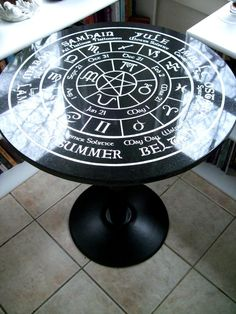 """Beautiful 24"""" round Black Italian Marble Table fully Engraved with the Pagan Wheel of the Year Calendar! This wheel signifies the turning of the Pagan calendar consisting of 8 holidays.Also, dates coincide with the proper Astrological symbols for the years cycle. Yule-December 20-23rd (This is the winter solstice) it marks the start of the New Year in Norse and Roman times. Norse for """"wheel."""" as it is a symbol that the year has turned. Imbolc/Candlemas Northern Hemisphere Date: February 2nd…"""