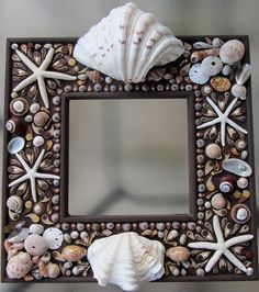 Cottage Chic Shells Beach Theme Mirror OOAK Custom Made Hand Crafted Wall Art Wall Decor Mirror Vintage Inspired Shabby Chic. $500.00, via Etsy.