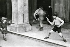 Henri Cartier-Bresson - Rome, Italy (Children Playing Cowboys with Guns)