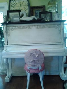 Beautiful antique piano, painted white and dark waxed. Makes a beautiful setting at a vintage wedding