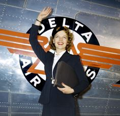 A lovely, smartly attired early 1940s Delta Airlines flight attendant. My grandmother wore that.