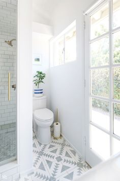 """When David and I started renovating our little 50's house last year, the bathrooms were not on our initial to-do list. They really weren't all that terrible and I had convinced myself that the built-in vanities were actually kind of cute in that """"they-don't-make-things-the-way-they-used-to"""" way. But after a series of unfortunate events that began with the intention of simply updating the leaky galvanized plumbing, which then led to us having to tear down said vintage vanities, which the..."""